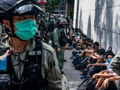 HONG KONG, CHINA - MAY 27: Riot police mass detain pro-democracy protesters during a rally in Causeway Bay district on May 27, 2020 in Hong Kong, China. Chinese Premier Li Keqiang said on Friday during the National People's Congress that Beijing would establish a sound legal system and enforcement mechanism …