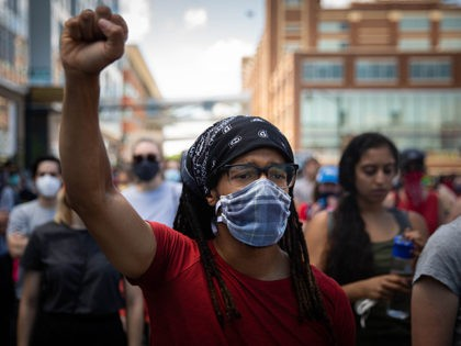 A protester raises a first during a demonstration against racism and police brutality in Pittsburgh, Pennsylvania, on June 6, 2020. - Demonstrations are being held across the US following the death of George Floyd on May 25, 2020, while being arrested in Minneapolis, Minnesota. (Photo by Maranie R. STAAB / …