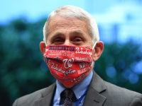 WASHINGTON, DC - JUNE 23: Dr. Anthony Fauci, director of the National Institute for Allergy and Infectious Diseases, wears a face mask bearing the name of the Major League Baseball Washington Nationals before a hearing of the House Committee on Energy and Commerce on Capitol Hill on June 23, 2020 …