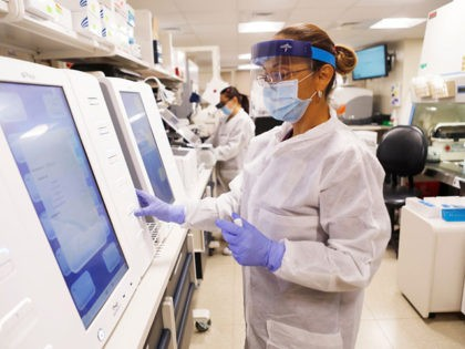 TAMPA, FL - JUNE 25: Adriana Cardenas, a medical technologist processes test samples for the coronavirus at the AdventHealth Tampa labs on June 25, 2020 in Tampa, Florida. Florida is currently experiencing a surge in COVID-19 cases, as the state reached a new record for single-day infections on Wednesday with …