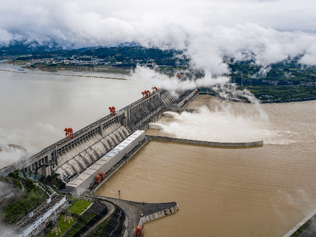 This aerial picture taken on June 29, 2020 shows wbeing ater released from the Three Gorges Dam, a gigantic hydropower project on the Yangtze river, in Yichang, central China's Hubei province. - The Three Gorges Dam released water for the first time this year, as a preparation of the upcoming …