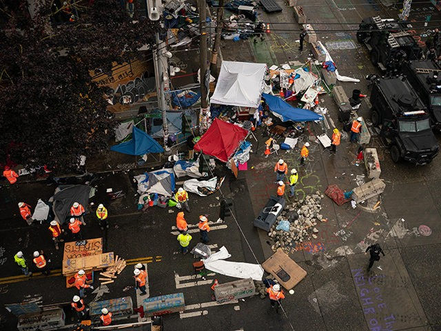 SEATTLE, WA - JULY 01: City crews dismantle the Capitol Hill Organized Protest (CHOP) area outside of the Seattle Police Department's vacated East Precinct on July 1, 2020 in Seattle, Washington. Police reported making 23 arrests since clearing the CHOP area this morning. (Photo by David Ryder/Getty Images)