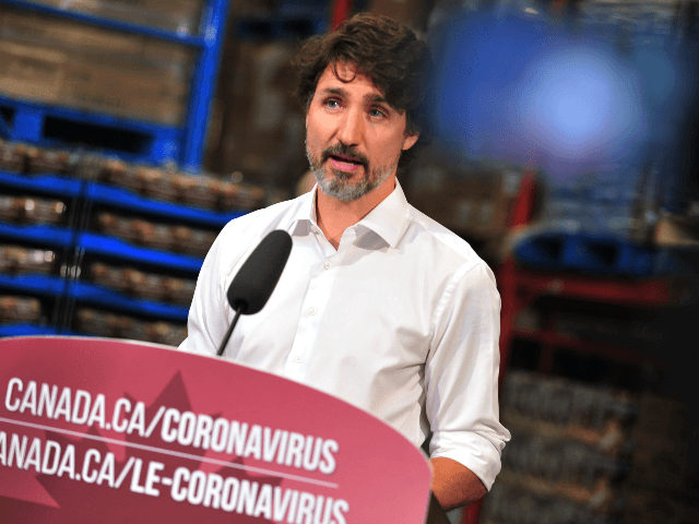Canadian Prime Minister Justin Trudeau speaks to the press as he volunteers at the Moisson Outaouais food bank in Gatineau, Quebec, Canada, on July 3, 2020, during the coronavirus pandemic. (Photo by Kadri MOHAMED / AFP) (Photo by KADRI MOHAMED/AFP via Getty Images)
