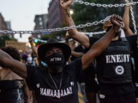MINNEAPOLIS, MN - JULY 04: Demonstrators carry chains during the Black 4th protest in downtown on July 4, 2020 in Minneapolis, Minnesota. A number of protest demonstrations occurred around the Twin Cities on Independence Day which were critical of the annual American celebration. (Photo by Stephen Maturen/Getty Images)