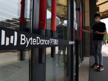 The ByteDance logo is seen at the entrance to a ByteDance office in Beijing on July 8, 2020. - Video sharing app TikTok, which is owned by Chinese company ByteDance, announced on July 6 it was pulling out of Hong Kong, less than a week after a new national security …