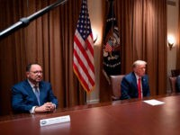 President of Goya Foods Robert Unanue (L), Florida Lt. Governor Jeanette Nunez (2R) and Lourdes Aguirre (R) listen to US President Donald Trump speak before signing an Executive Order on the White House Hispanic Prosperity Initiative at the White House in Washington, DC, on July 9, 2020. (Photo by JIM …