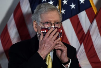 US Senate Majority Leader Mitch McConnell, adjusts his mask after a Republican policy luncheon on Capitol Hill in Washington on July 21, 2020. (Photo by Olivier DOULIERY / AFP) (Photo by OLIVIER DOULIERY/AFP via Getty Images)