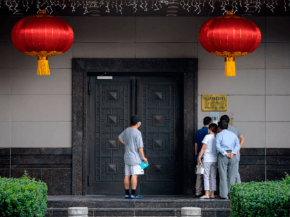 People attempt to talk to someone at the Chinese consulate in Houston on July 22, 2020. - US-Chinese tensions, already rising because of the coronavirus pandemic and crackdown in Hong Kong, ratcheted up another notch on Wednesday as the US ordered the closure of the Chinese consulate in Houston within …