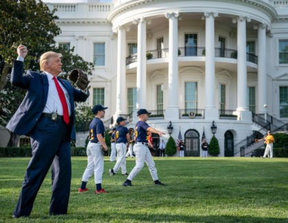 WASHINGTON, DC - JULY 23: U.S. President Donald Trump throws a baseball on the South Lawn of the White House on July 23, 2020 in Washington, DC. President Trump and former New York Yankees Hall of Fame pitcher Mariano Rivera met with youth baseball players to celebrate Opening Day of …