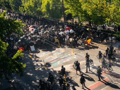 Police push demonstrators back atop a Black Lives Matter street mural in the area formerly known as CHOP during protests in Seattle on July 25, 2020 in Seattle, Washington. Police and demonstrators clash as protests continue in the city following reports that federal agents may have been sent to the …