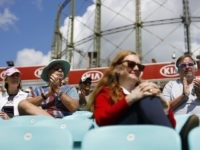 Spectators sit socially distanced leaving spaces between groups as a precaution against the spread of the novel coronavirus as they watch the friendly county cricket match between Surrey and Middlesex at the Oval in London on July 26, 2020. - The friendly cricket match between Surrey and Middlesex on July …
