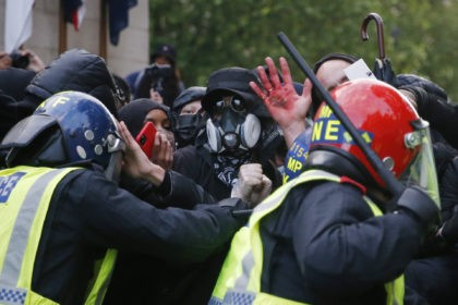 LONDON, UNITED KINGDOM - JUNE 06: Protesters clash with Police Officers during a Black Lives matter march through central London on June 6, 2020 in London, United Kingdom. The death of an African-American man, George Floyd, while in the custody of Minneapolis police has sparked protests across the United States, …