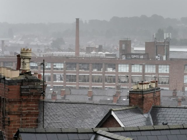 LEICESTER, ENGLAND - JULY 09: Inclement weather shrouds the roofs of homes and factories in Leicester's North Evington and Spinney Hills neighbourhood on July 09, 2020 in Leicester, England. Businesses in the city had to close again on June 30 after a spike in coronavirus cases. Elsewhere in England, pubs, …