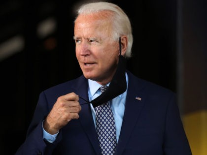 DUNMORE, PENNSYLVANIA - JULY 09: The presumptive Democratic presidential nominee Joe Biden walks on to stage as he speaks at McGregor Industries on July 09, 2020 in Dunmore, Pennsylvania. The former vice president, who grew up in nearby Scranton, toured a metal works plant in Dunmore in northeastern Pennsylvania and …