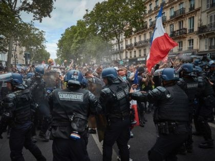 PARIS, FRANCE - JULY 14: French Police push back protestors and spray pepper spray during an Bastille Day Anti Government Protest near Place de la Bastille on July 14, 2020 in Paris, France. Due to the COVID-19 pandemic many Bastille Day events have been cancelled. (Photo by Kiran Ridley/Getty Images)