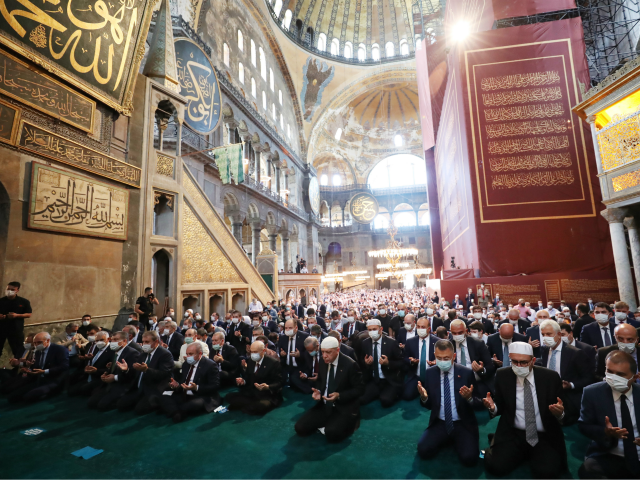 ISTANBUL, TURKEY - JULY 24: In this handout picture released by the Turkish Presidential press office, Turkey's President Recep Tayyip Erdogan (C) and invited guests attend Friday prayers at Hagia Sophia Grand Mosque during the buildings first official prayers after being reconverted into a mosque on July, 24, 2020 in …