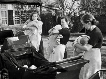 Mothers holding their newborn babies outside Fircroft post-natal home, Buckinghamshire, 8th May 1943. Original Publication : Picture Post - 1435 - Post Natal Homes: What Mrs Churchill Wants To See - pub. 1943 (Photo by Kurt Hutton/Picture Post/Hulton Archive/Getty Images)