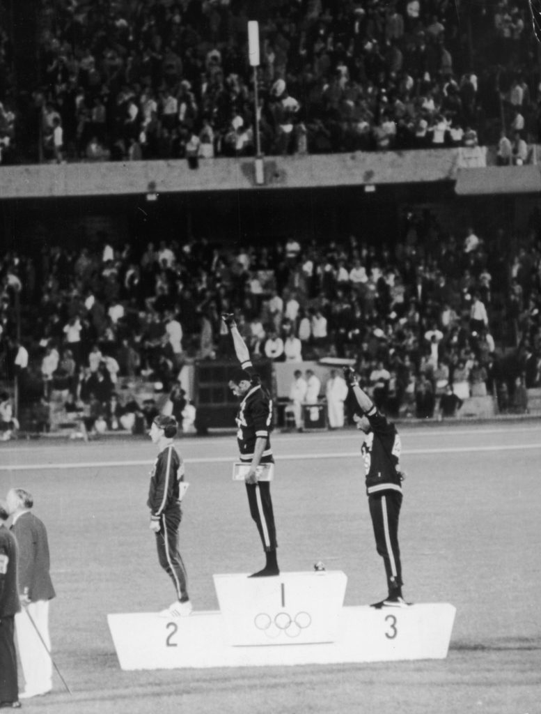 American track and field athletes Tommie Smith and John Carlos, first and third place winners in the 200 meter race, protest with the Black Power salute as they stand on the winner's podium at the 1968 Summer Olympic games, Mexico City, Mexico. (Hulton Archive/Getty Images)