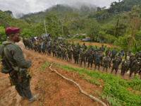 """Members of the Revolutionary Armed Forces of Colombia (FARC) guerrillas are seen at the """"Alfonso Artiaga"""" Front 29 FARC encampment in a rural area of Policarpa, department of Narino in southwestern Colombia, on January 17, 2017. The UN is overseeing the FARC's disarmament as part of a peace deal the …"""
