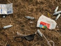 Discarded nitrous oxide canisters are scattered on the ground in front of the Pyramid Stage at the end of the Glastonbury Festival of Music and Performing Arts on Worthy Farm near the village of Pilton in Somerset, South West England, on June 26, 2017. / AFP PHOTO / Oli SCARFF …