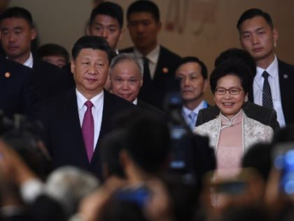 Hong Kong's new Chief Executive Carrie Lam (centre R) arrives with China's President Xi Jinping (front L) before being sworn in as the territory's new leader at the Hong Kong Convention and Exhibition Centre in Hong Kong on July 1, 2017. Lam became Hong Kong's new leader on July 1, …