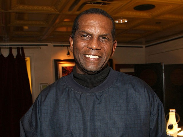 "NEW YORK - NOVEMBER 07: NFL star Burgess Owens attends the welcome reception for ""A Salute To Our Troops"" weekend hosted by Microsoft and the USO at the Hard Rock Cafe on November 7, 2008 in New York City. (Photo by Jason Kempin/Getty Images for Microsoft)"