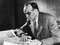 American urban planner and New York City Parks Department Commissioner Robert Moses (1888 - 1981), Robert Moses works with a map at his desk, 1958. (Photo by Archive Photos/Getty Images)