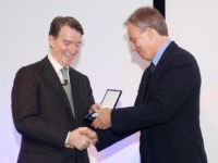 British First Secretary of State Lord Mandelson (L) presents former British Prime Minister Tony Blair with the Fenner Brockway medal for his contribution to UK-India relations during a reception at Deutsche Bank in central London, on July 3, 2009. AFP PHOTO/Leon Neal (Photo credit should read Leon Neal/AFP via Getty …