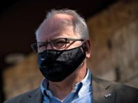 MINNEAPOLIS, MN - JUNE 05: Minnesota Governor Tim Walz tours damaged buildings on East Lake Street on June 5, 2020 in Minneapolis, Minnesota. Walz, Sen. Tina Smith (D-MN), and Sen. Amy Klobuchar (D-MN) joined business owners and community members to tour properties which were damaged during the protests and riots …