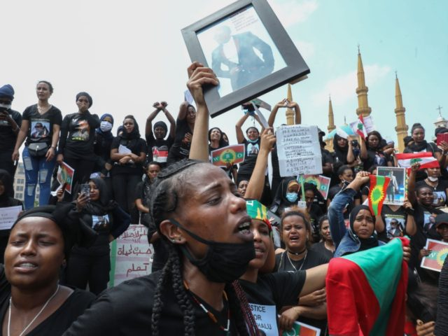 Members of the Oromo Ethiopian community in Lebanon take part in a demonstration to protest the death of musician and activist Hachalu Hundessa, in the capital Beirut on July 5, 2020. - Hundessa was shot and killed in the Ethiopian capital Addis Ababa on June 29, 2020. His death has …