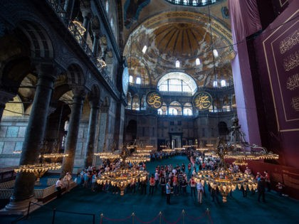 ISTANBUL, TURKEY - JULY 24: People visit Hagia Sophia Mosque after the first official Friday prayers on July 24, 2020 in Istanbul, Turkey. Turkey's President Recep Tayyip Erdogan attended the first Friday prayer inside the Hagia Sophia Mosque after it was officially reconverted into a mosque from a museum. The …