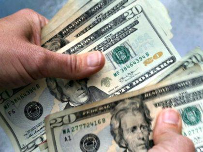 Hands Holding $20 Bills