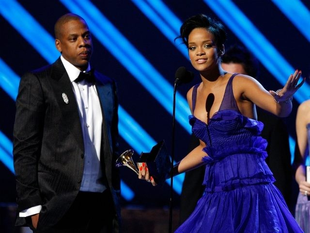 LOS ANGELES, CA - FEBRUARY 10: Rapper Jay-Z (L) and singer Rihanna accept the Best Rap/Sung Collaberation award onstage during the 50th annual Grammy awards held at the Staples Center on February 10, 2008 in Los Angeles, California. (Photo by Kevin Winter/Getty Images)