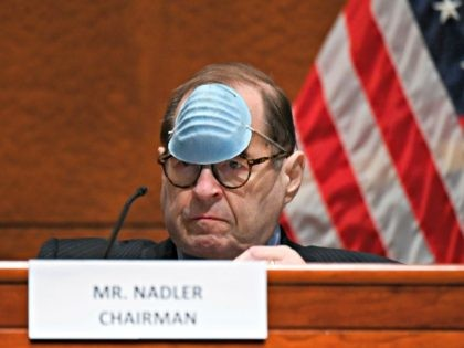 House Judiciary Committee Chairman Jerry Nadler, D-N.Y., adjusts his mask to drink a beverage during a House Judiciary Committee markup of the Justice in Policing Act of 2020 on Capitol Hill in Washington, Wednesday, June 17, 2020. (Erin Scott/Pool via AP)