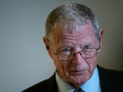 Sen. James Inhofe (R-OK) talks with reporters before a Senate GOP lunch meeting in the Russell Senate Office Building on Capitol Hill March 20, 2020 in Washington, DC. Lawmaker and Trump administration officials are in negotiations about the phase 3 coronavirus stimulus bill, which leaders say they hope to have …