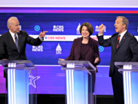 CHARLESTON, SOUTH CAROLINA - FEBRUARY 25: Democratic presidential candidates former Vice President Joe Biden (L) and Tom Steyer (R) debate as Sen. Amy Klobuchar (D-MN) reacts during the Democratic presidential primary debate at the Charleston Gaillard Center on February 25, 2020 in Charleston, South Carolina. Seven candidates qualified for the …