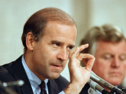 Senate Judiciary Chairman Joseph Biden D-Del., gestures while speaking to Supreme Court nominee Robert Bork during confirmation hearings before the committee on Capitol Hill in Washington, Sept. 15, 1987. Bork will appear for additional questioning by committee members on Wednesday. (AP Photo/John Duricka)