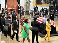 WASHINGTON, DC - JULY 27: Family members depart at the conclusion of memorial ceremony for former Rep. John Lewis (D-GA) in the Capitol Rotunda on July 27, 2020 in Washington, DC. Lewis, a civil rights icon and fierce advocate of voting rights for African Americans, will lie in state at …