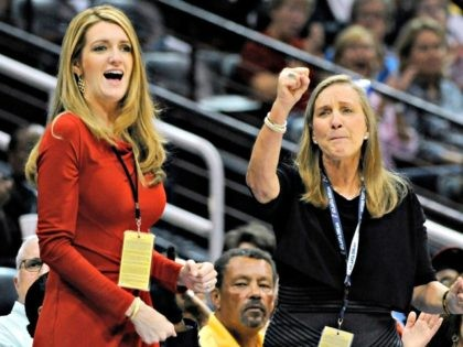 FILE-In this Sept. 6, 2011 file photo, Mary Brock, right, and Kelly Loeffler cheer from their courtside seats as the Atlanta Dream basketball team plays in the second half of their WNBA basketball game, in Atlanta. A GOP political consultant told The Associated Press that Georgia Gov. Brian Kemp decided …
