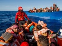 Members of the Spanish NGO Maydayterraneo take a group of migrants from Bangladesh, Afghanistan and Pakistan to the Aita Mari rescue boat during the rescue of 65 migrants in the Mediterranean international waters off the Libyan coast on February 10, 2020. - With the 65 people rescued today, a total …