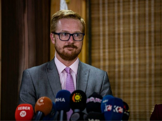 Labour MP Lloyd Russell- Moyle (L), spokesman of a delegation of British parliamentarians, addresses the media on his team's second visit to the Kurdish region in northern Syria, following a meeting with the local foreign relations authority in the Kurdish-majority city of Qamishli late on September 16, 2019 - The …