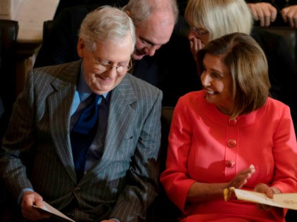 Speaker of the House Nancy Pelosi (R) and Senate Majority Leader Mitch McConnell at a Congressional Gold Medal ceremony honoring former National Football League (NFL) player and advocate for patients with Lou Gehrig's disease, Steve Gleason, on Capitol Hill in Washington, DC, on January 15, 2020. (Photo by JIM WATSON …