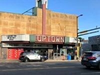 A police vehicle is parked outside the Uptown Theatre Sunday, June 21, 2020, following a shooting in Minneapolis' Uptown neighborhood. Multiple people were shot, one fatally, when gunfire broke out shortly after midnight Sunday. (AP Photo/Doug Glass)