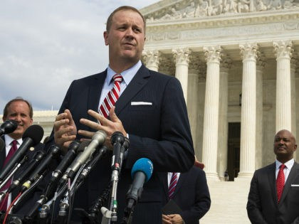 FILE - In this Sept. 9, 2019, file photo, Missouri Attorney General Eric Schmitt speaks in front of the U.S. Supreme Court in Washington. Schmitt on Tuesday, April 21, 2020, filed a lawsuit against the Chinese government, the Community Party of China and others, alleging that the hiding of information …