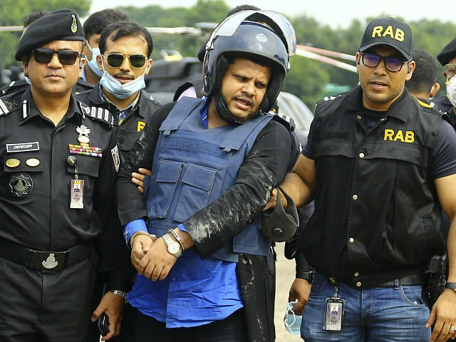 Mohammed Shahed, center, the owner of two hospitals that issued thousands of fake coronavirus test reports is brought by helicopter after being arrested by Bangladesh's Rapid Action Battalion personnel in Dhaka, Bangladesh, Wednesday July 15, 2020. Shahed, a member of the governing party who regularly appeared on TV talk shows, …