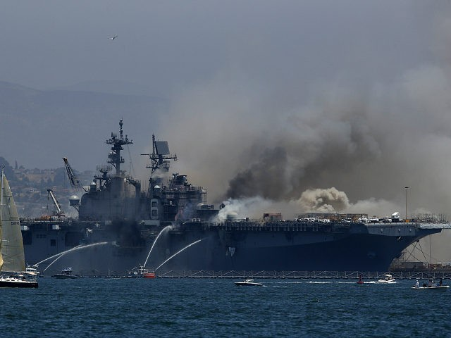 SAN DIEGO, CALIFORNIA - JULY 12: A fire burns on the amphibious assault ship USS Bonhomme Richard at Naval Base San Diego on July 12, 2020 in San Diego, California. There was an explosion on board the ship with multiple injuries reported. (Photo by Sean M. Haffey/Getty Images)