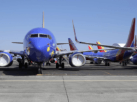 Southwest Airlines airplanes sit parked Tuesday, April 7, 2020, at Paine Field airport in Everett, Wash. A steep decline in travel due to the outbreak of the coronavirus has pushed airlines to cancel flights, run fewer planes and seek government aid. (AP Photo/Ted S. Warren)