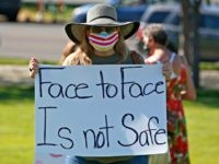Kris Reddout, a 5th grade teacher, attends a Utah Safe Schools Mask-In urging the governor's leadership in school reopening during a rally Thursday, July 23, 2020, in Salt Lake City. Parents and teachers rallied at the Utah State Capitol Thursday morning to urge schools to enforce mask wearing and to …