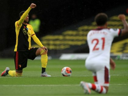 Watford's French midfielder Etienne Capoue (L) gestures in support of the Black Lives Matter movement during the English Premier League football match between Watford and Southampton at Vicarage Road Stadium in Watford, north of London on June 28, 2020. (Photo by ADAM DAVY/POOL/AFP via Getty Images)