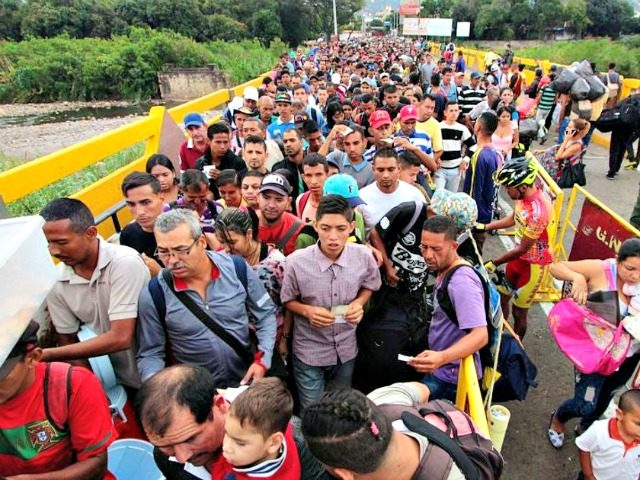 Venezuelan citizens cross the Simon Bolivar International Bridge from San Antonio del Tachira in Venezuela to the Norte de Santander province of Colombia.GEORGE CASTELLANOS/AFP/Getty Images